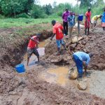 The Water Project: Lutonyi Community, Lutomia Spring -  Diverting Water And Laying The Foundation