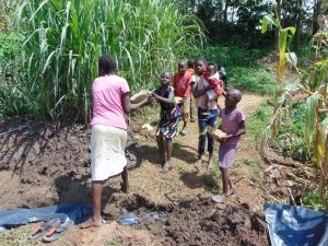 The Water Project:  Children Bring Materials To Site