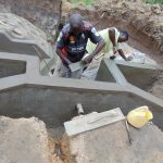 The Water Project: Ikonyero Community, Amkongo Spring -  Adding Plaster