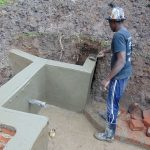 The Water Project: Buyangu Community, Osundwa Spring -  Plaster Continues