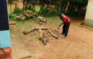 The Water Project:  School Staff Splitting Firewood For Cooking