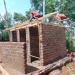 The Water Project: Magaka Primary School -  Building Latrine Roofs