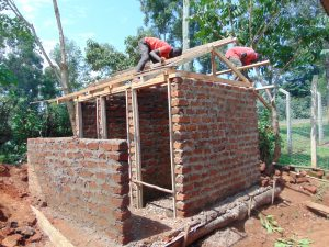 The Water Project:  Building Latrine Roofs