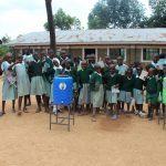 The Water Project: Lwanga Itulubini Primary School -  Training Complete Posing With Handwashing Stations