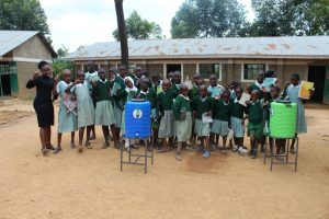 The Water Project:  Training Complete Posing With Handwashing Stations