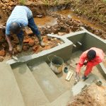 The Water Project: Lutonyi Community, Lutomia Spring -  Plastering