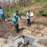 The Water Project: Shihungu Community, Shihungu Spring -  Backfilling Continues With Help From Community Members