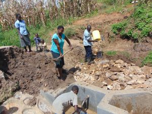 The Water Project:  Backfilling Continues With Help From Community Members