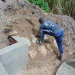 The Water Project: Buyangu Community, Osundwa Spring -  Rub Wall Construction