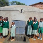 The Water Project: Lwanga Itulubini Primary School -  Students With The New Tank