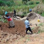 The Water Project: Shihungu Community, Shihungu Spring -  Soil Backfilling