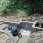 The Water Project: Buyangu Community, Osundwa Spring -  Tile Setting