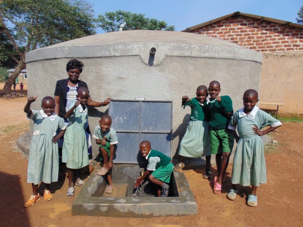 The Water Project : 15-kenya19049-celebrating-the-rain-tank