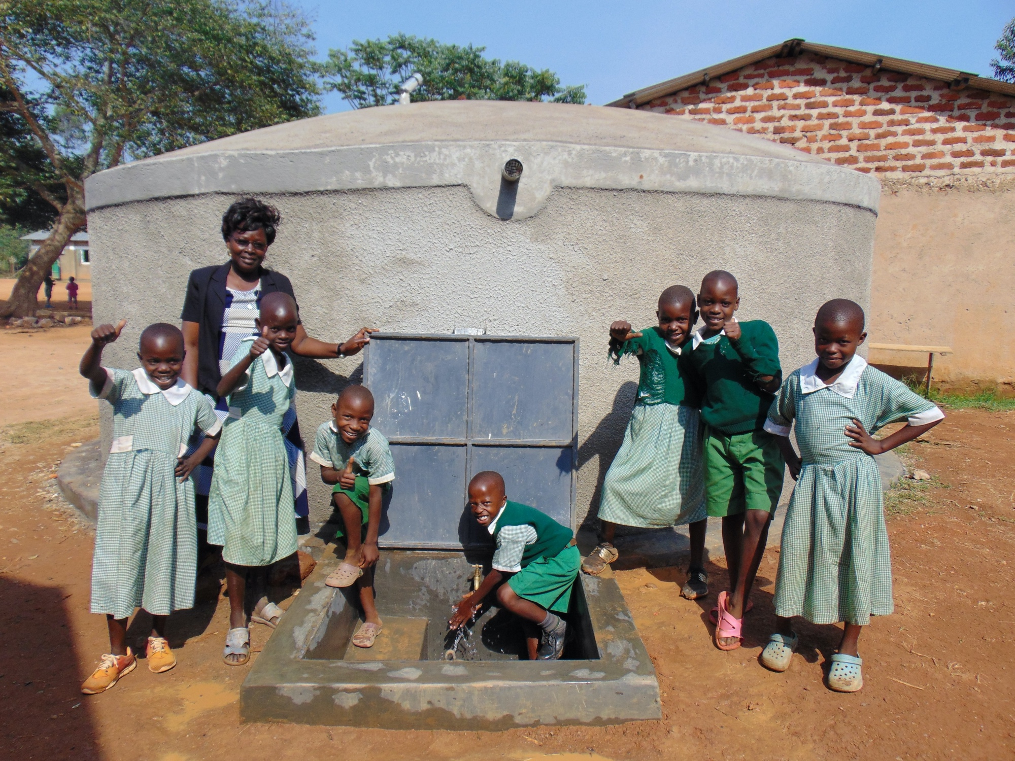 The Water Project : 15-kenya19049-celebrating-the-rain-tank