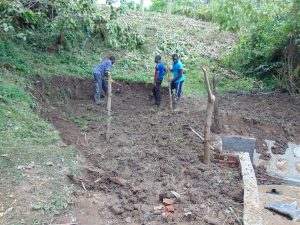 The Water Project:  Backfilling With Soil And Fencing