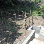 The Water Project: Buyangu Community, Osundwa Spring -  Fenced Spring With Grass Planted
