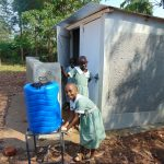 The Water Project: Lwanga Itulubini Primary School -  Handwashing Outside The Latrines
