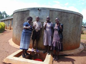 The Water Project:  Mrs Lodeki Students And Rose At The Rain Tank