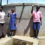 The Water Project: Makuchi Primary School -  Madam Misiko Linda And Moses At The Tank