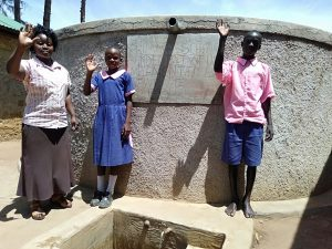 The Water Project:  Madam Misiko Linda And Moses At The Tank
