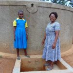 The Water Project: Lugango Primary School -  Mary With Sanitation Teacher Mrs Jessica Mideva