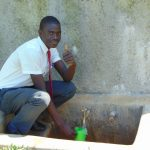 The Water Project: St. John Cheptech Secondary School -  Derrick Magweli At The Rain Tanks Tap