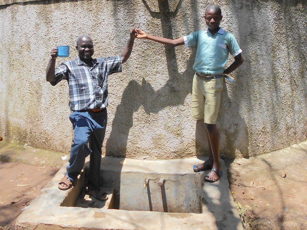 The Water Project : 2-kenya18078-mr-chibole-withfranklin-majimbo