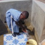 The Water Project: Chebwayi B Community, Wambutsi Spring -  Ages Tom Washes Her Hands With Spring Water