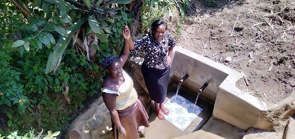 The Water Project : 2-kenya18123-medline-and-field-officer-karen-maruti-join-hands