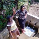 The Water Project: Matsakha Community, Mbakaya Spring -  Medline And Field Officer Karen Maruti Join Hands