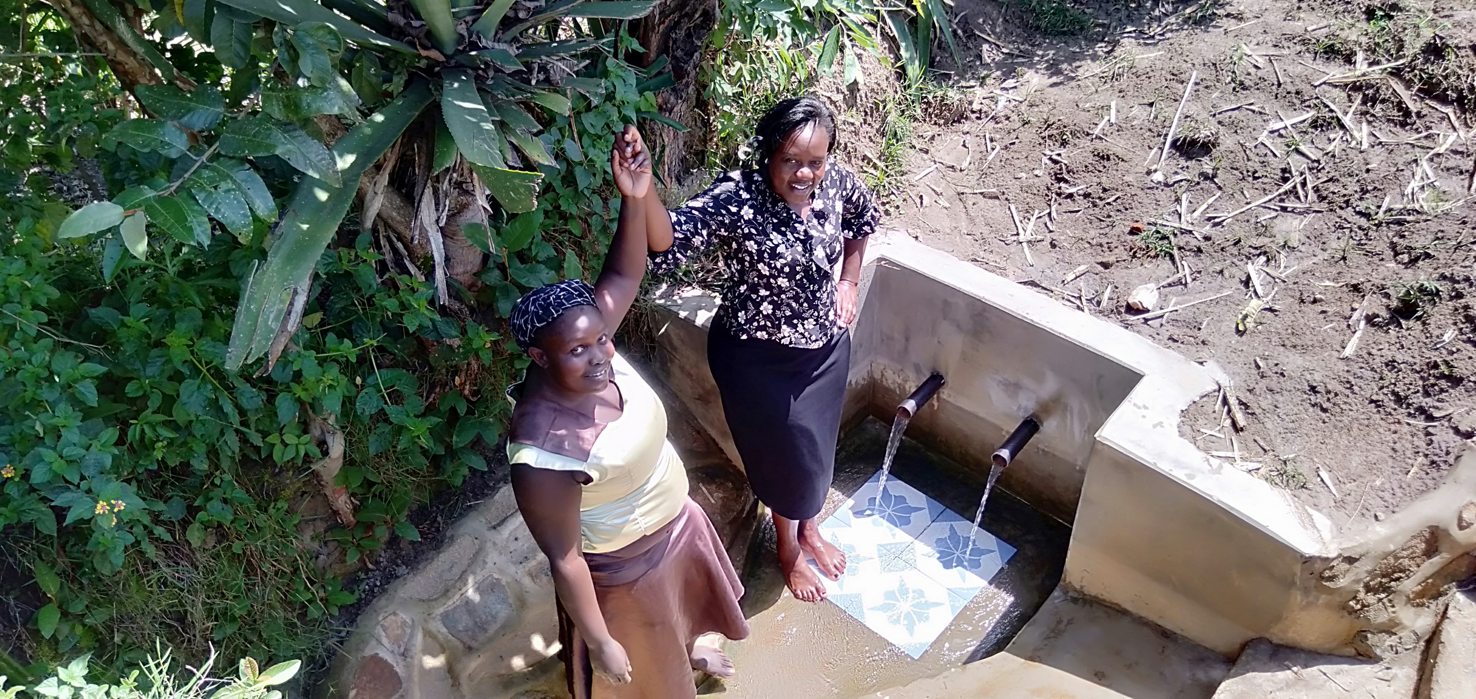 The Water Project : 2-kenya18123-medline-and-field-officer-karen-maruti-join-hands