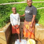 The Water Project: Handidi Community, Chisembe Spring -  Michelle Mushila With Field Officer Betty Muhongo