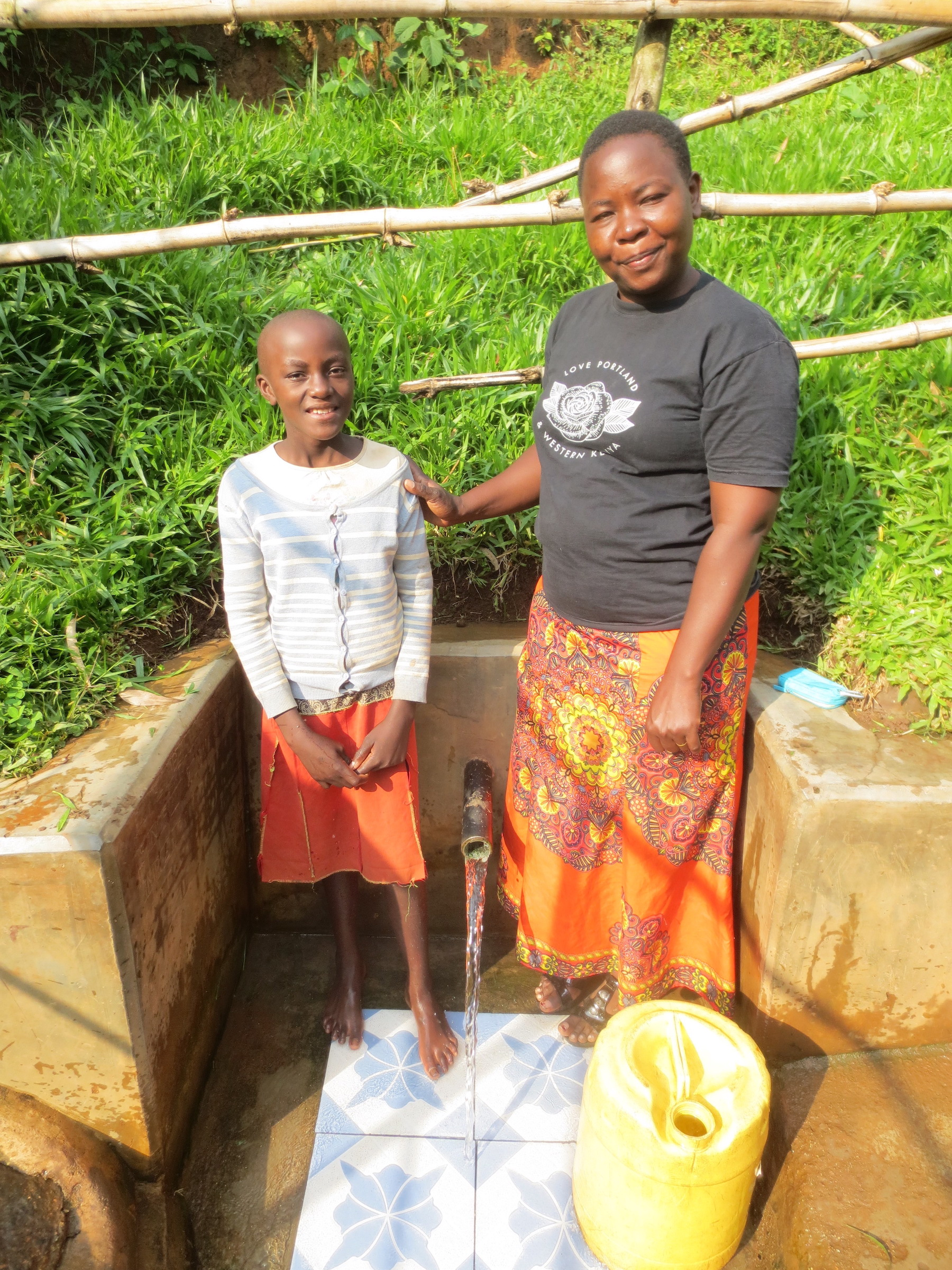 The Water Project : 2-kenya18126-michelle-mushila-with-field-officer-betty-muhongo