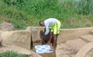 The Water Project:  Elias Masinde Enjoying The Spring Water