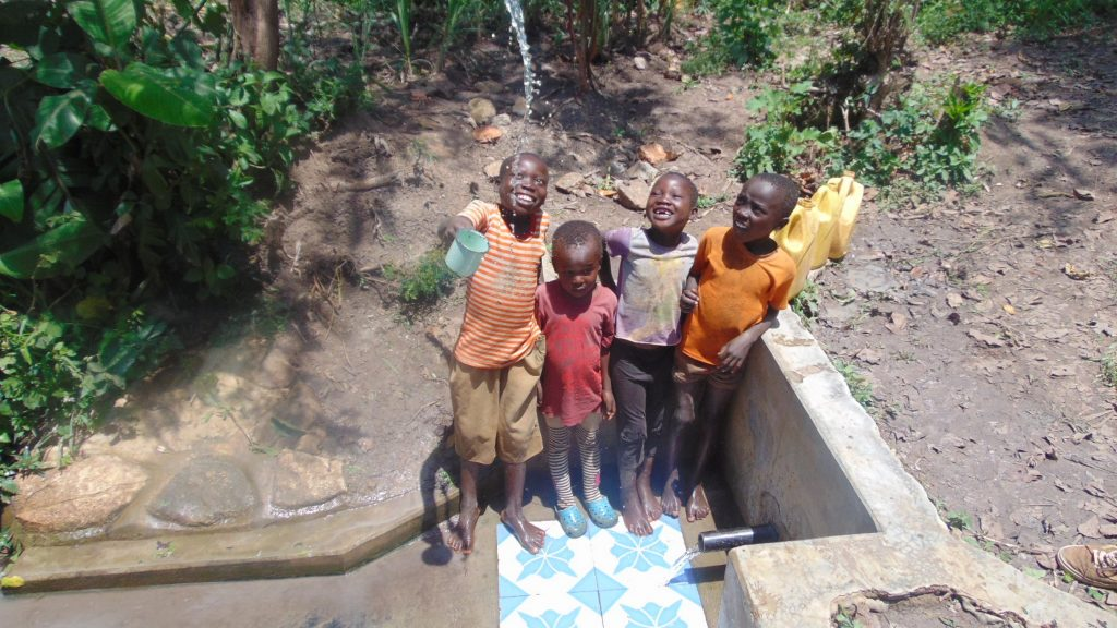 The Water Project : 2-kenya18134-kids-play-with-spring-water