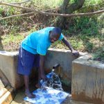The Water Project: Mungaha B Community, Maria Spring -  Charles Mutwaro Gets A Drink