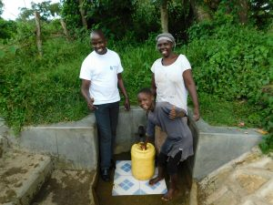 The Water Project:  Field Officer Jonathan Mutai With Jackline Baraza And Veline