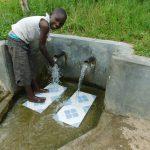The Water Project: Muyundi Community, Ngalame Spring -  Edwin Shikhanga Enjoying The Spring Water