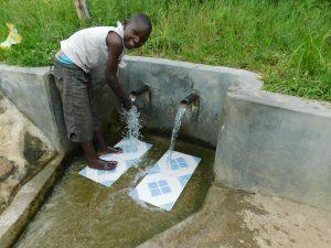 The Water Project:  Edwin Shikhanga Enjoying The Spring Water