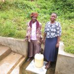 The Water Project: Emachembe Community, Hosea Spring -  Annet And Field Officer Betty Muhongo