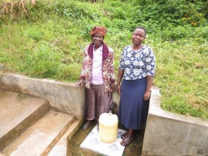 The Water Project:  Annet And Field Officer Betty Muhongo
