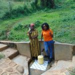The Water Project: Isembe Community, Amwayi Spring -  Josephine Ambani With Field Officer Georgina Kamau