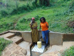 The Water Project:  Josephine Ambani With Field Officer Georgina Kamau
