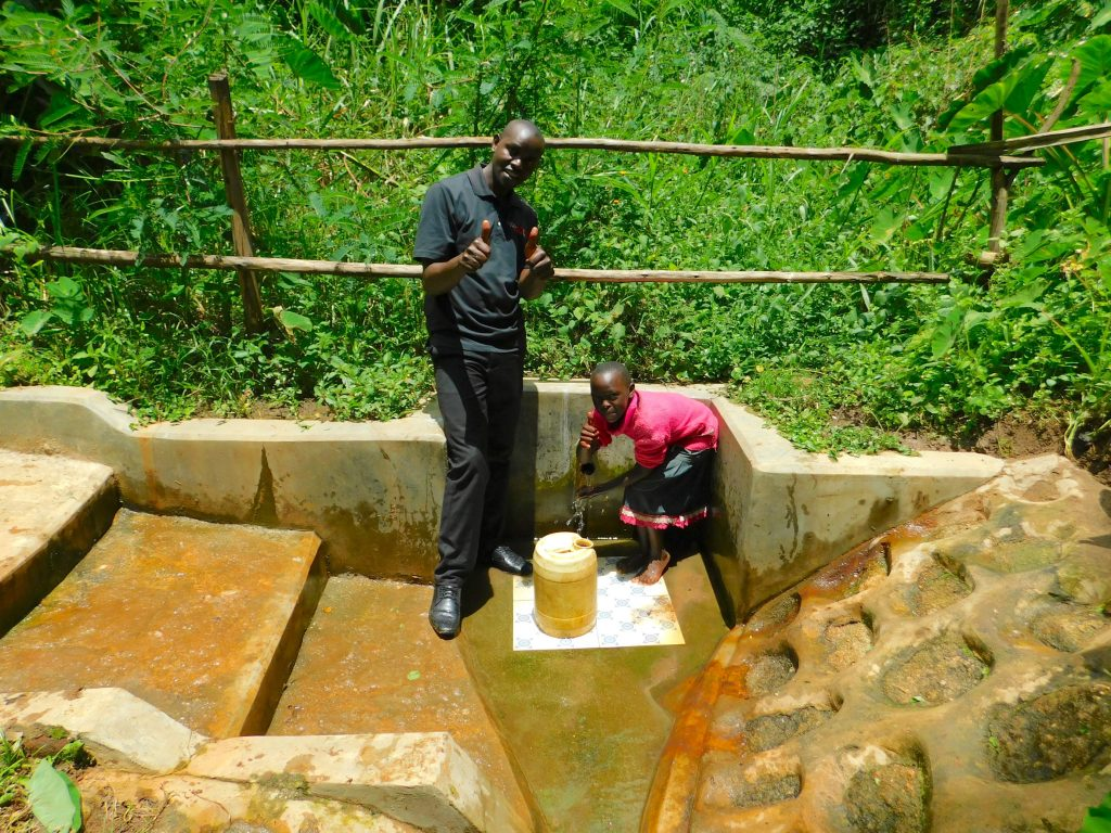 The Water Project : 2-kenya18160-field-officer-wilson-kipchoge-with-shaline