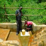 The Water Project: Koitabut Community, Henry Kichwen Spring -  Field Officer Wilson Kipchoge With Shaline