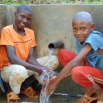 The Water Project: Upper Visiru Community, Wambosani Spring -  Young Boys Enjoying The Spring Water