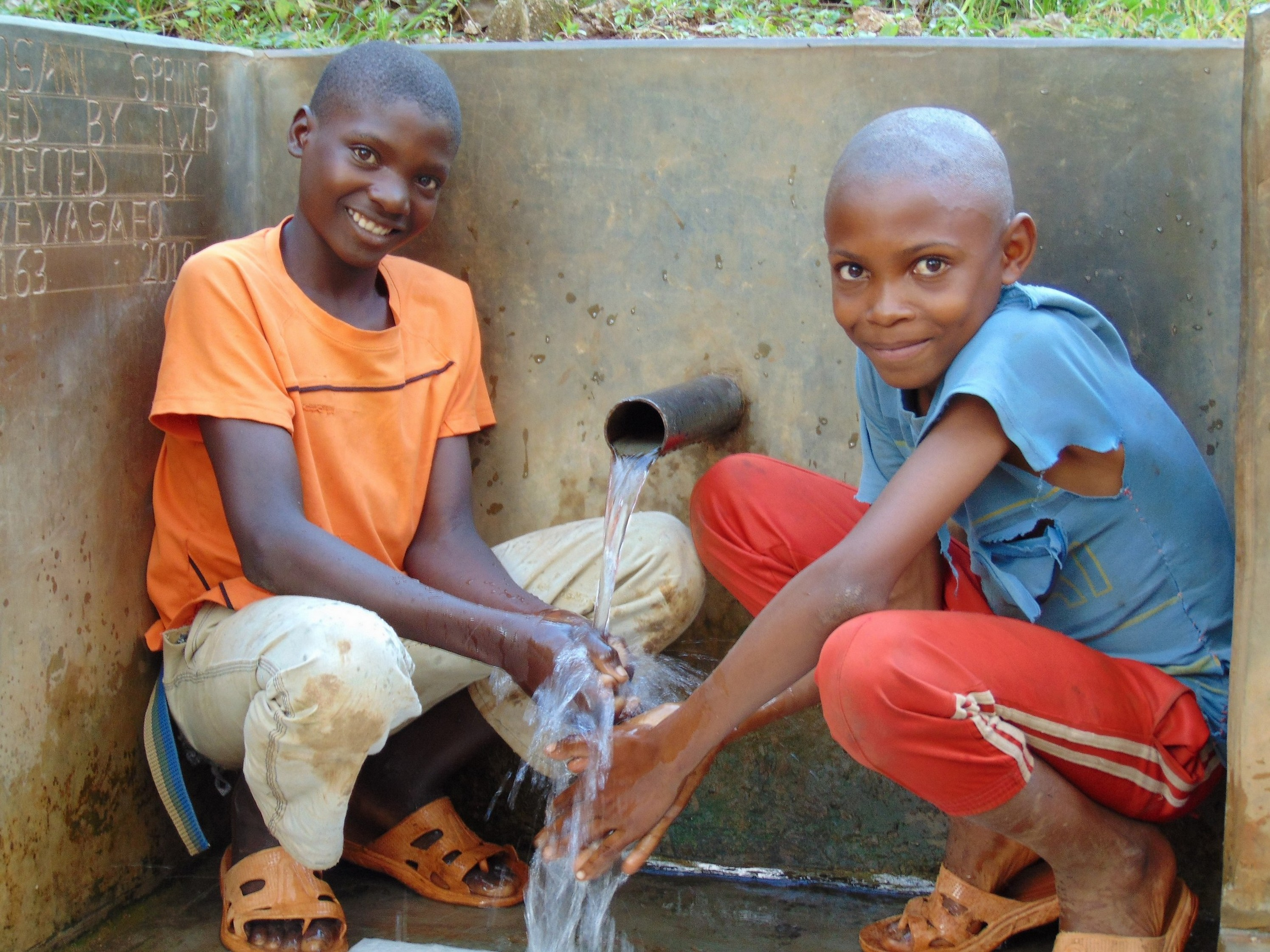 The Water Project : 2-kenya18163-young-boys-enjoying-the-spring-water