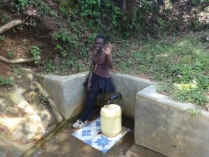 The Water Project:  Babra Kati Waves Hello From The Spring