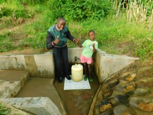 The Water Project:  Field Officer Jonathan Mutai And Ivine Muchema