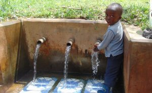 The Water Project:  Young Boy At The Spring